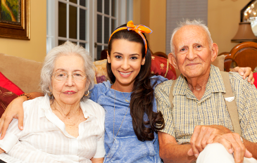 senior couple and their caregiver