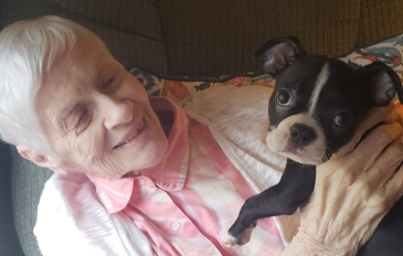 senior and her caregiver smiling